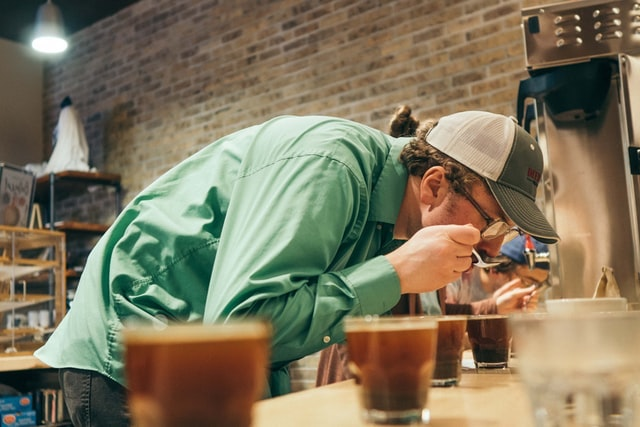 Man Sampling Different Cups of Coffee