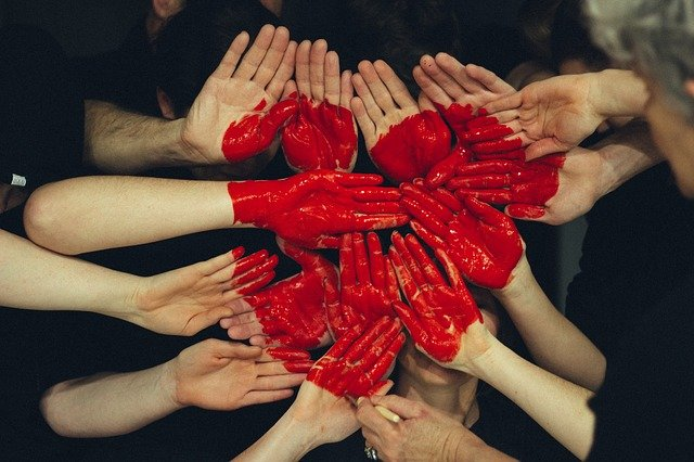 A group of people with their hands together