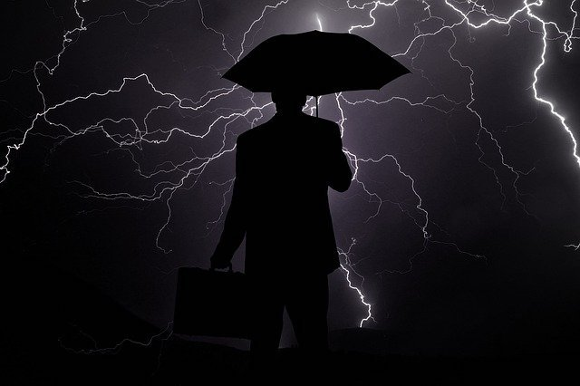 Black and white illustration of a man holding an umbrella