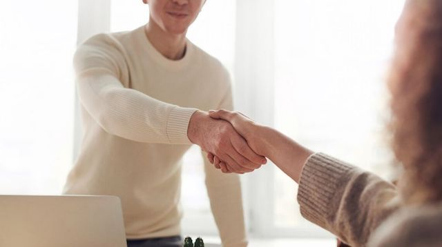 Business Ethics Two People Shaking Hands