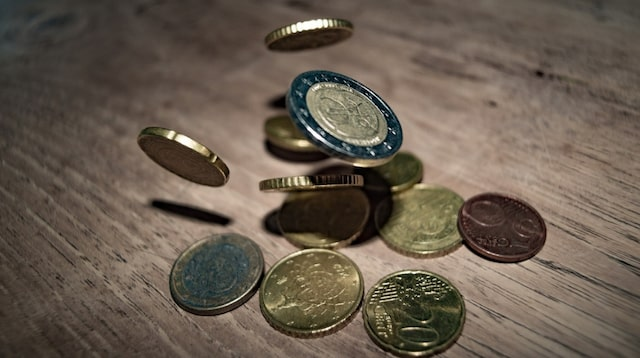 Cash Flow Statement Coins Bouncing on a Table