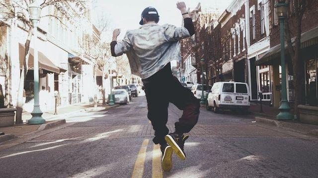 Communication Plan Man Jumping in Street
