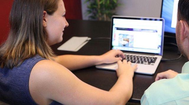 Digital Marketing Woman Working at Laptop