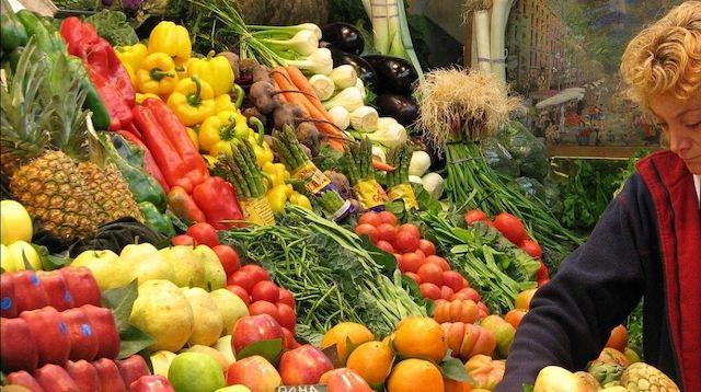 Employee Engagement Woman Restocking Fresh Vegetables