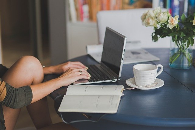 Gig Economy Woman Working on Laptop