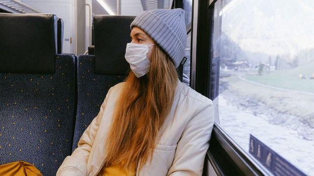 Global Economic Crisis Woman on Public Transport