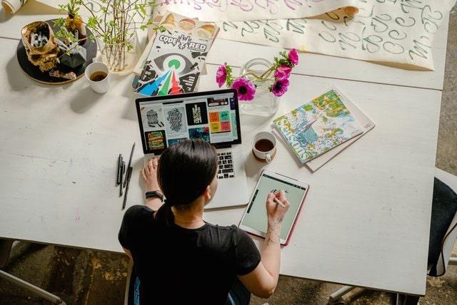 Graphic designer working at a desk