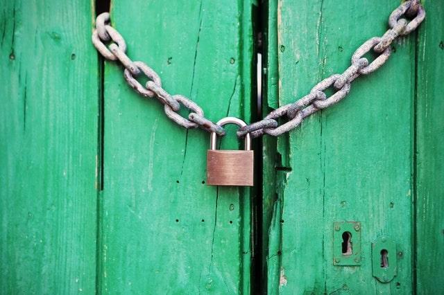 Green barn door with chain and padlock