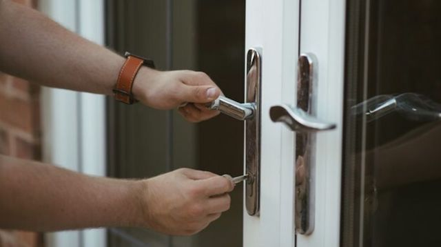 How to Become a Real Estate Agent Man Unlocking Door