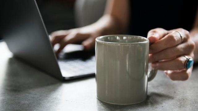 Real Estate License Woman on Laptop