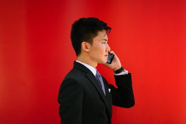 Real Estate License Man Holding Smartphone