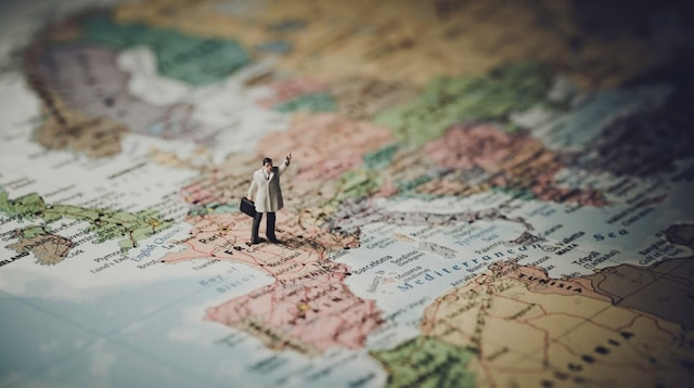 Market Segmentation Doll Standing on Map