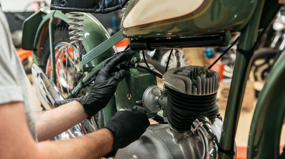 Person repairing a motorbike