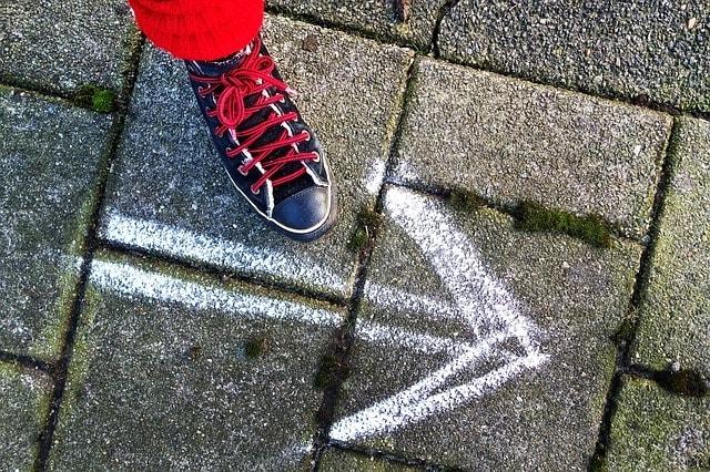 Retirement Planning Arrow Drawn on Pavement