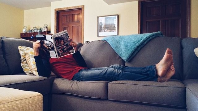 Stress Management Man Reading on Couch