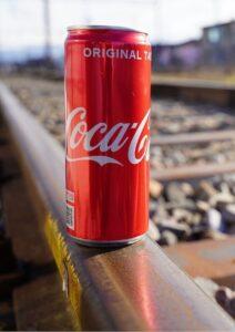 Trade Secrets Coca Cola Can on Rail Tracks