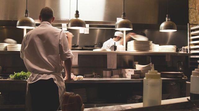 Two men working in a restaurant kitchen