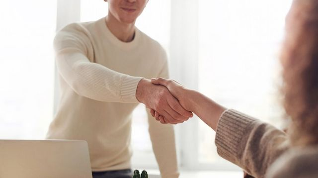 Web Design Two People Shaking Hands