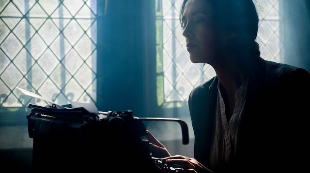 Woman Using Typewriter