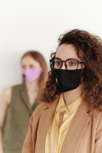 Workplace Health and Safety Two Women Wearing Masks