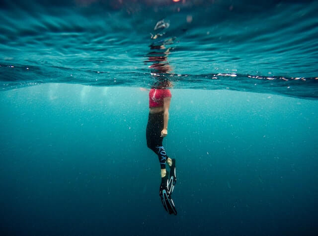 Underwater photo of a woman wearing flippers