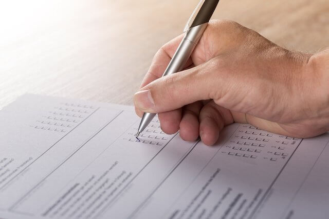Closeup of person filling out a survey