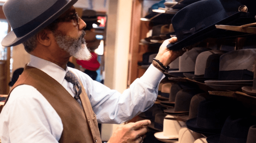 Succession Planning Man Looking at Hats