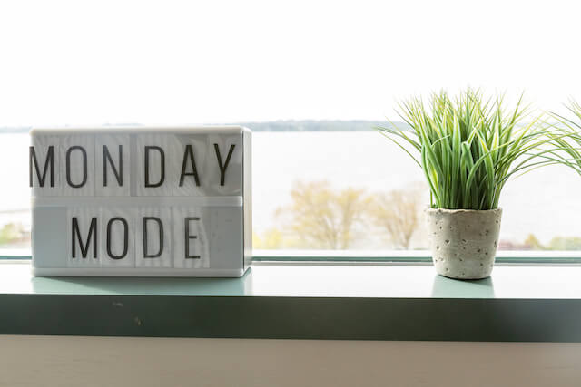 Monday mode sign sitting on a windowsill