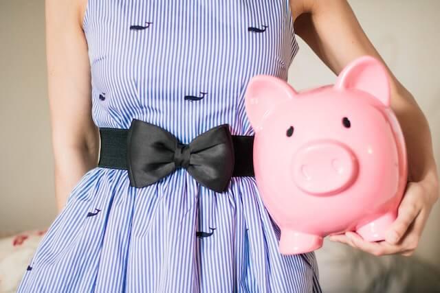 oman holding piggy bank