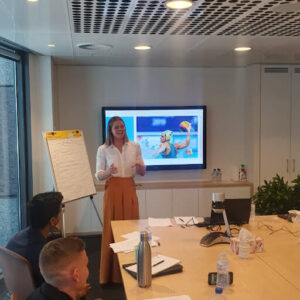 Woman presenting in front of screen with Keesja's image in background-1.jpg