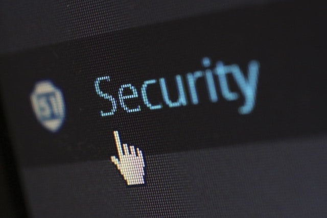 """Close-up of a computer cursor pointing at the word """"security"""""""