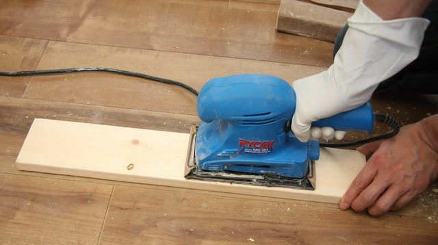 Carpentry Apprenticeship Sanding a Board