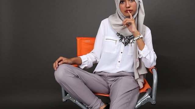 Fashion Job Model Posing in Orange Chair