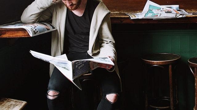 Newsletter Man Reading Newspaper