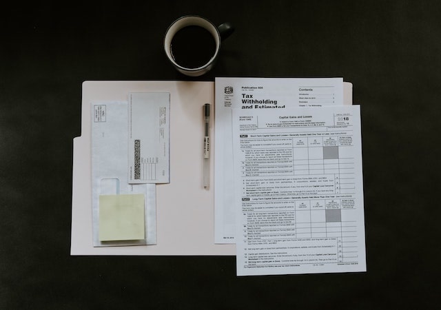 Open folder on desk containing tax information