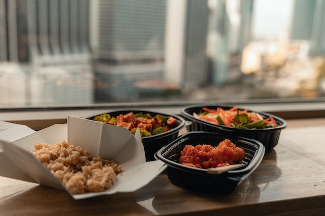 Takeout food sitting on a table overlooking a cityscape