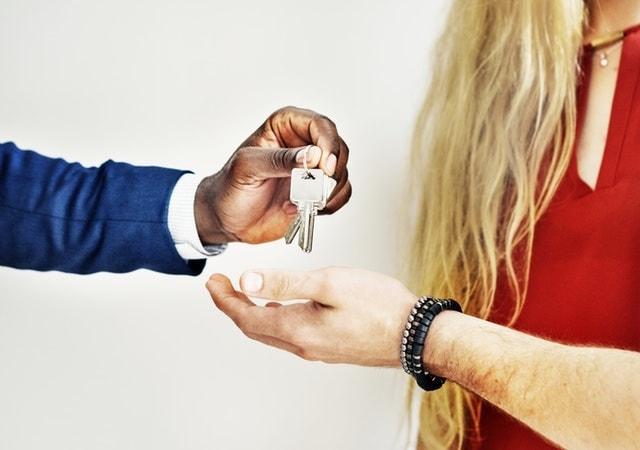 Website Design Someone Handing Keys to a Man