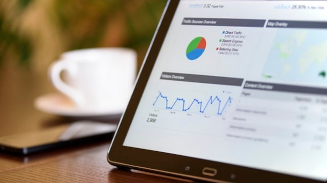 Website Design Tablet Displaying Google Analytics