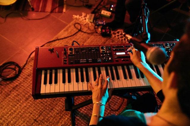 Woman playing keyboard in a music studio